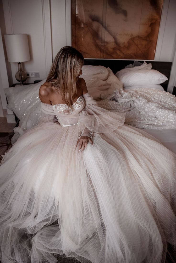 The #Bellina wedding gown is the jewel in our newest couture collection #Alegria. This dramatic ballerina ballgown is made of pleated silk tulle in shades of ivory and blush with embroidered embellishment detailing. Photo: by Tali Photography