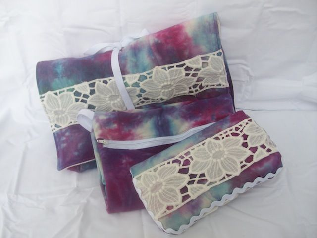 hand dyed embellished change kit: wipes case with six bamboo terry wipes, wet bag for getting messes home, and a roll up change mat with a pouch to hold it all!