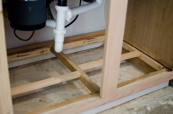 Replace Water Damaged Cabinet Bottom | Diy house projects ...