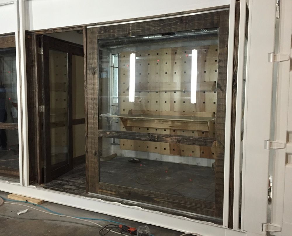 View Through An Office Window Of The Pegboard System In The End