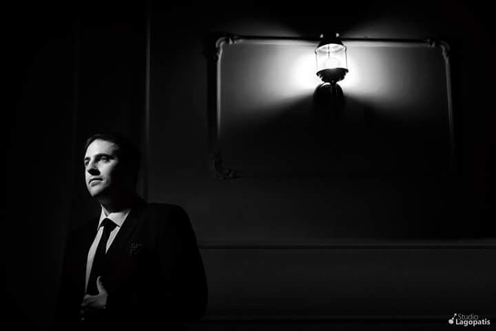 """""""Even in the deepest #darkness, there will always be a #light to guide you..."""" #blackandwhite #groom #groomportrait #wedding #weddingphotography #groompreparation #weddinginathens www.lagopatis.gr"""