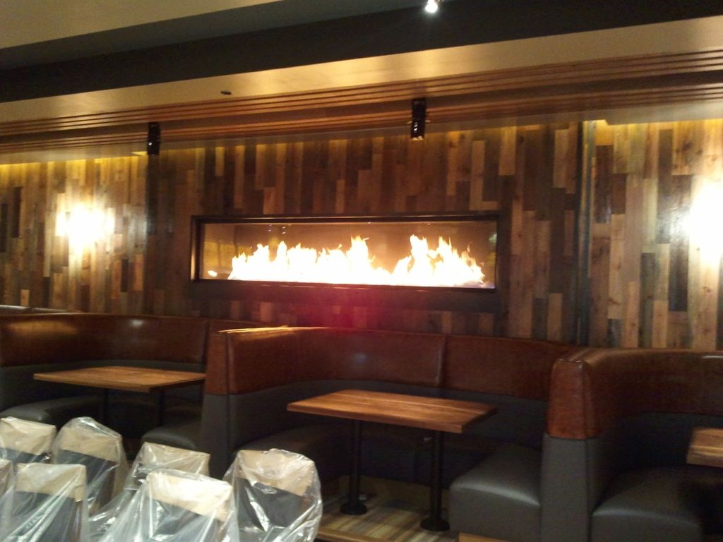 custom linear gas fireplace for houlihans restaurant designed by acucraft fireplaces