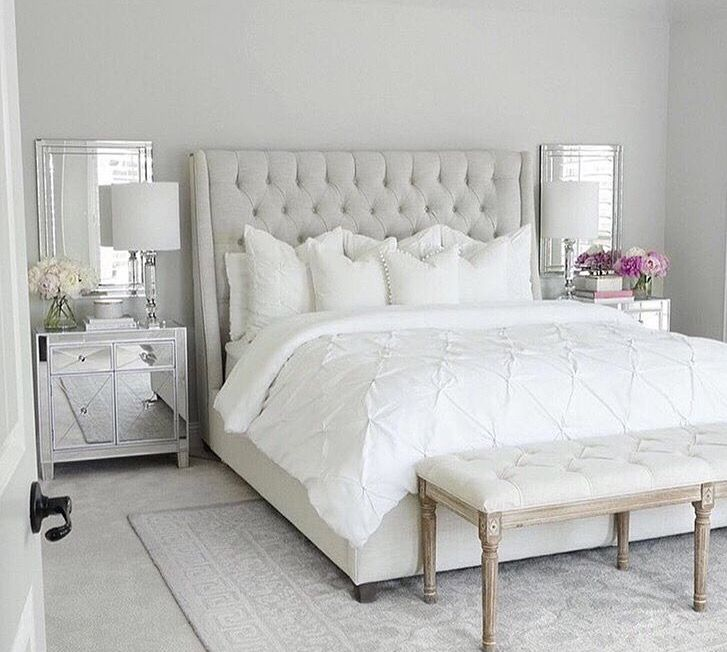 Transitional, neutral bedroom with mirrored nightstands adding a ...