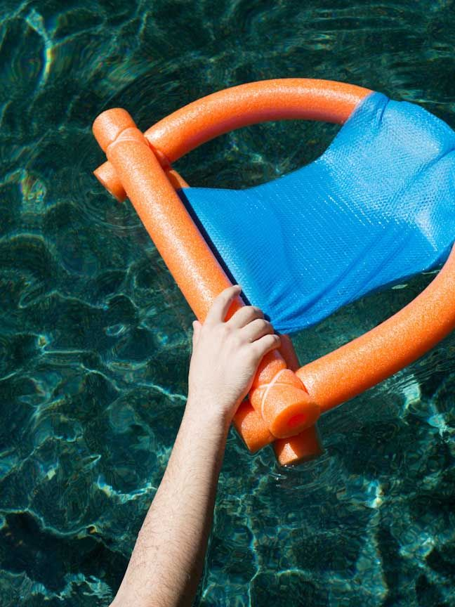 Easy DIY Pool Noodle Chair Float (Made With Materials from the Dollar Store)