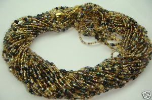 1,000 beads? More like thousands - rich warm winter colors - this is the only one I have left. Conition new -