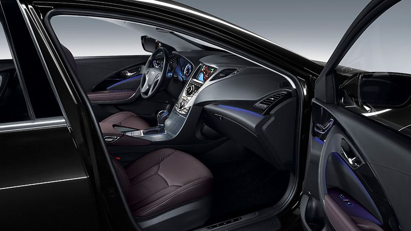 2012 AZERA IN CHESTNUT BROWN LEATHER WITH AMBIENT BLUE