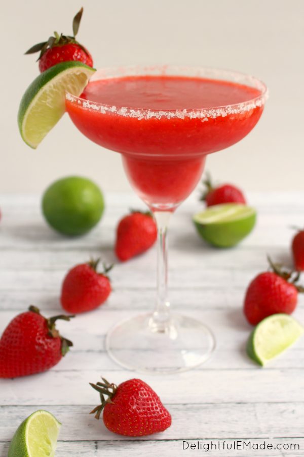 Bust out the tequila, its time for a Margarita!  Blended with frozen strawberries, lime juice, and rimmed with salt, these frozen margaritas are easy to make, wonderfully refreshing and an all-time favorite cocktail! #limemargarita Bust out the tequila, its time for a Margarita!  Blended with frozen strawberries, lime juice, and rimmed with salt, these frozen margaritas are easy to make, wonderfully refreshing and an all-time favorite cocktail! #frozenmargaritarecipes