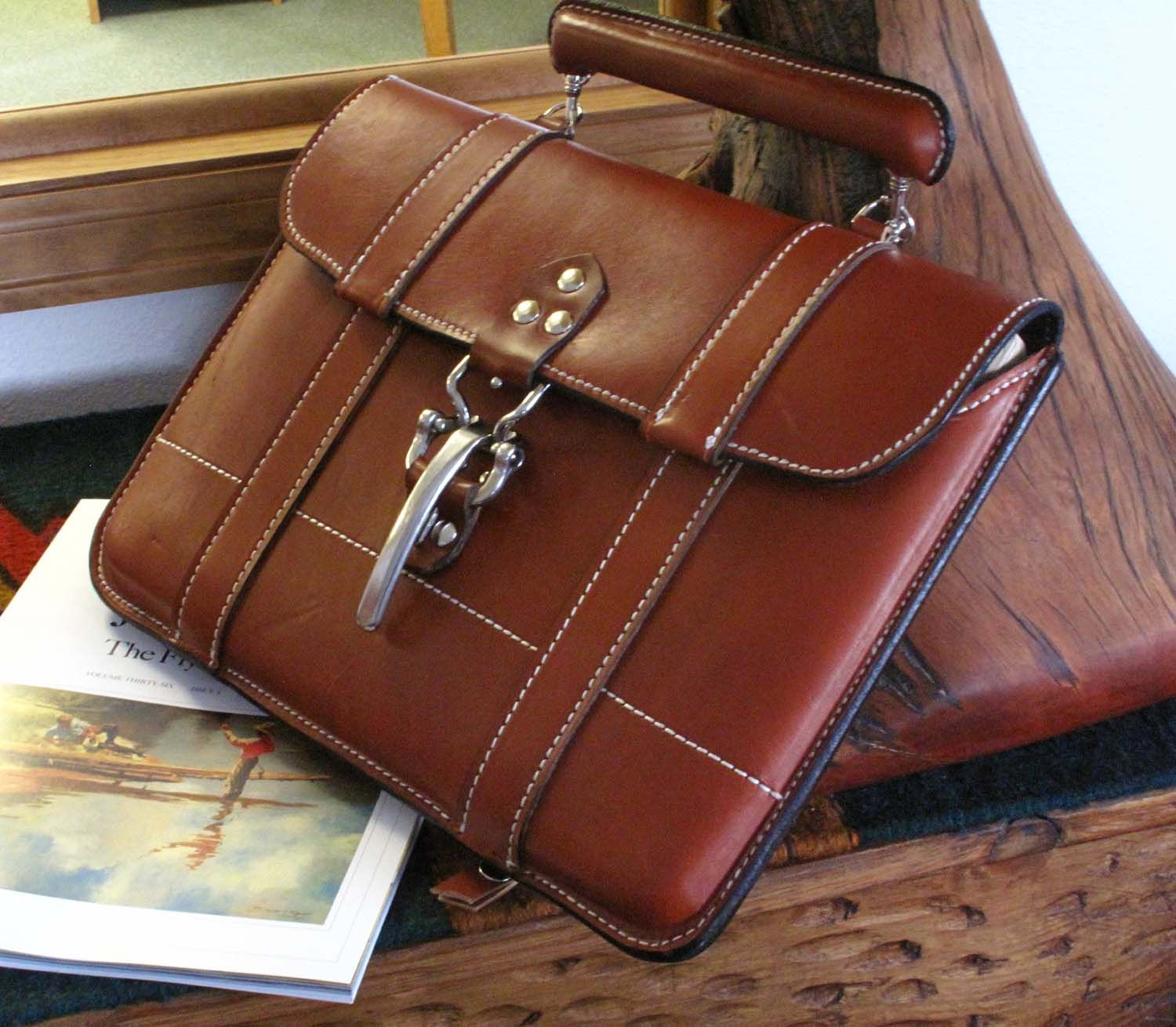 """Skytop System Laptop Case Authentic American head-turner, this satchel-style case is perfect for your laptop or iPad, newspaper, file folder and the day's paperwork. Clips to other Skytop System cases. Includes detachable """"canoe"""" handle and shoulder strap. Available in four colors."""