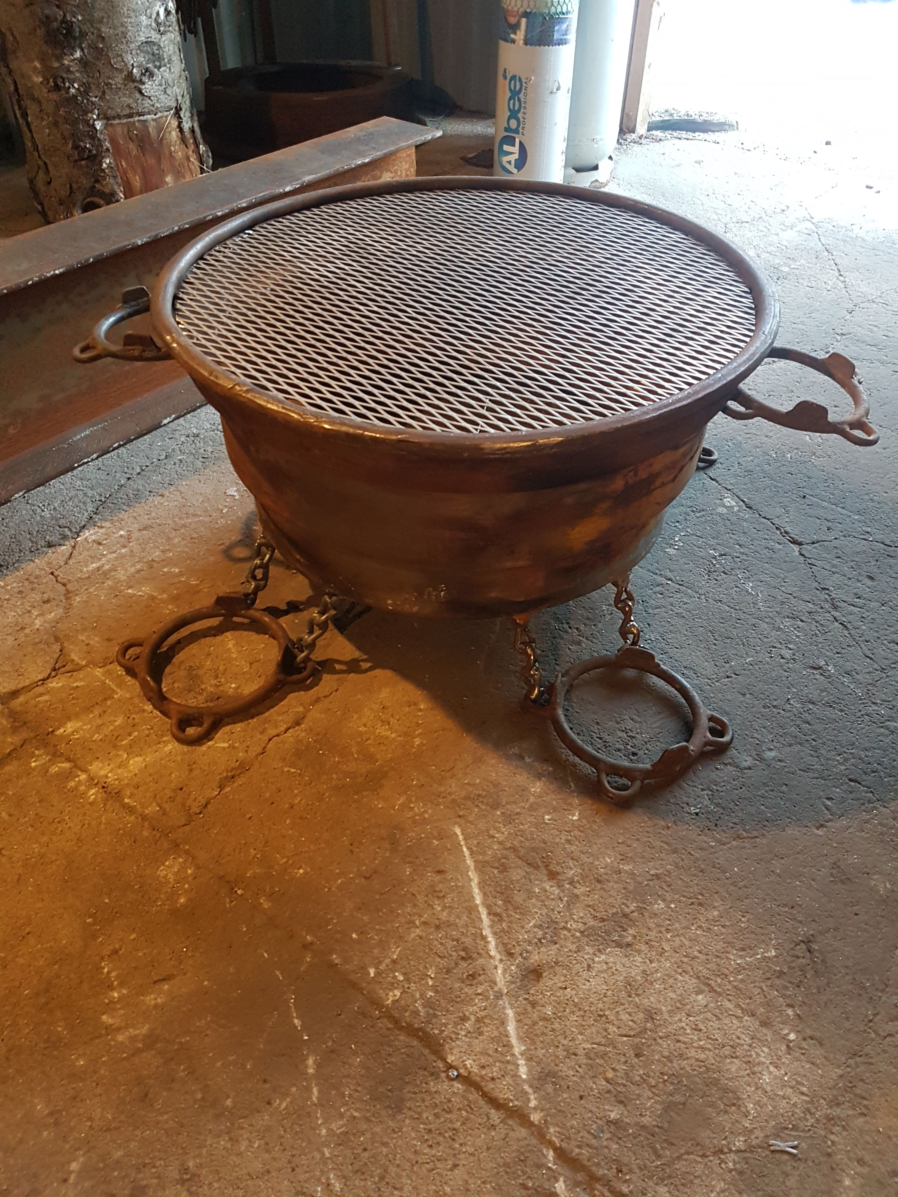 Fire pit. Made from big rim. Feet and handels from tractor ...