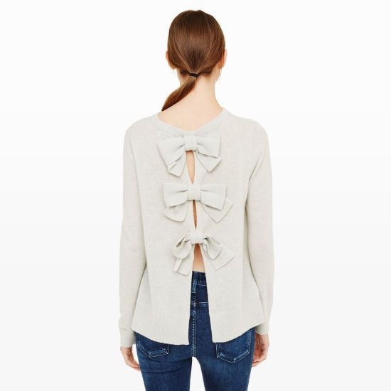 The bow makes a strong reemergence this season, as seen on the back of our cashmere Sidone. Featuring an otherwise minimal design, this sweater is a cool-weather staple that only gets better when you turn around. Cashmere Relaxed fit 23' in length from high point of shoulder to hem Open back with triple-bow detail; ribbed neck, cuffs, and hemline Dry clean Imported