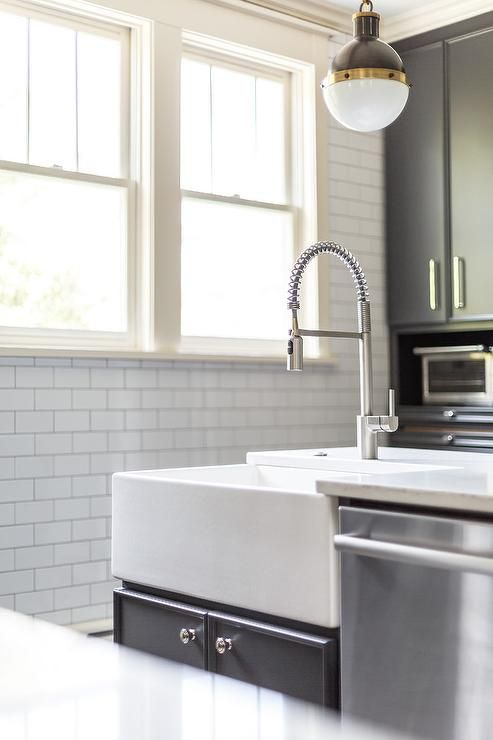 Contemporary Kitchen Features A Small Hicks Pendant Hung Above A Dark Gray Isla Kitchen Island With Sink And Dishwasher Grey Kitchen Island Kitchen Sink Design