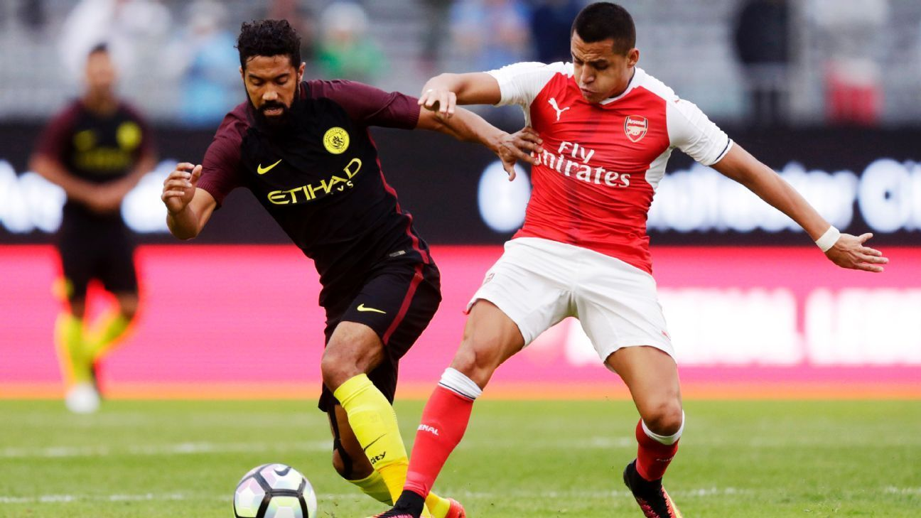 Arsenal rally to beat Man City with goals from Alex Iwobi