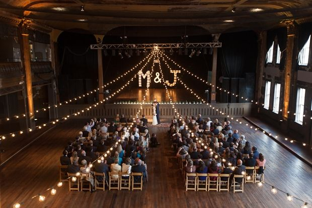 Theater Wedding With String Lights And Initial Monogram Backdrop