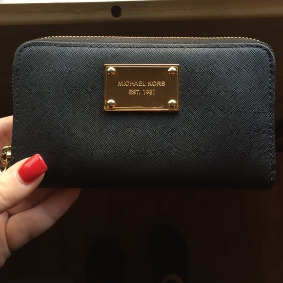 0c244514e135 ️Michael Kors Black Leather Wallet Very clean! No markings or wear on  leather. Wristlet style wallet with compartments inside. Some small marks  on front ...