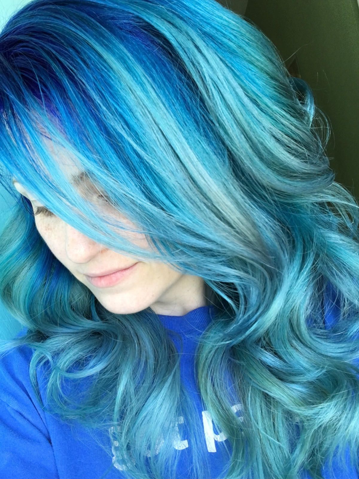 Aqua hair with a cobalt blue shadow root my hair clients too
