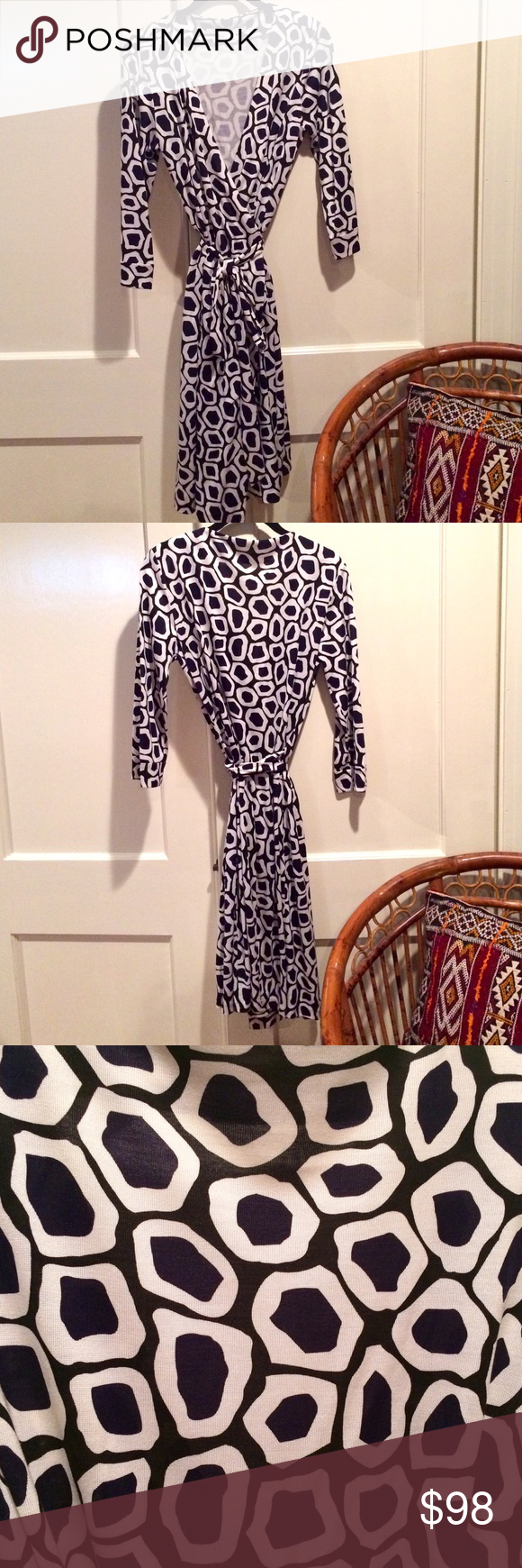 Classic wrap dress by Diane Von Furstenberg. Classic wrap dress by Diane Von Furstenberg. Julian Two style in black/white print. In excellent condition, worn once. Size 12, but fits like 8/10. Runs small. 100% Silk. Diane von Furstenberg Dresses Midi
