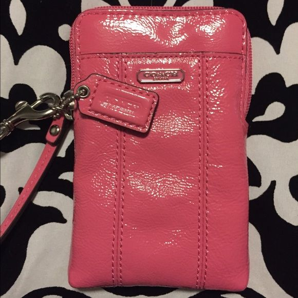 Authentic Leather Pink Coach Wristlet Never been used, in perfect condition, authentic pink Coach Wristlet. Has four slots on the inside, and one on the outside. Perfect for a phone, license, money, cards, lipstick, etc for a fun night out! Please let me know if you have any questions or would like additional photos. Coach Bags Clutches & Wristlets