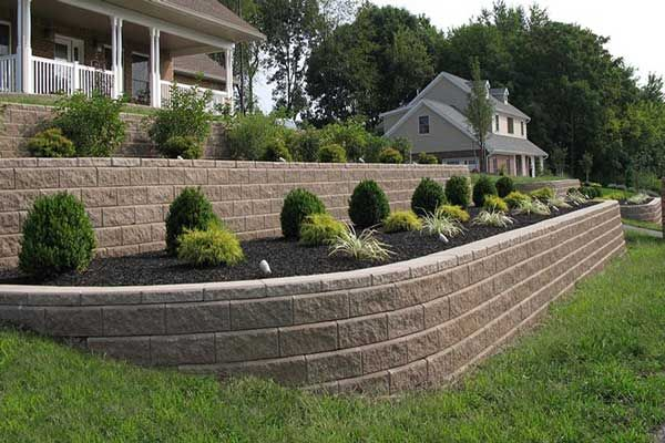 retaining wall tackles sloping front yard patio ideas pinterest