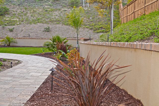 Stucco Retaining Wall Brick Cap Landscaping Retaining Walls Retaining Wall Bricks Backyard Remodel