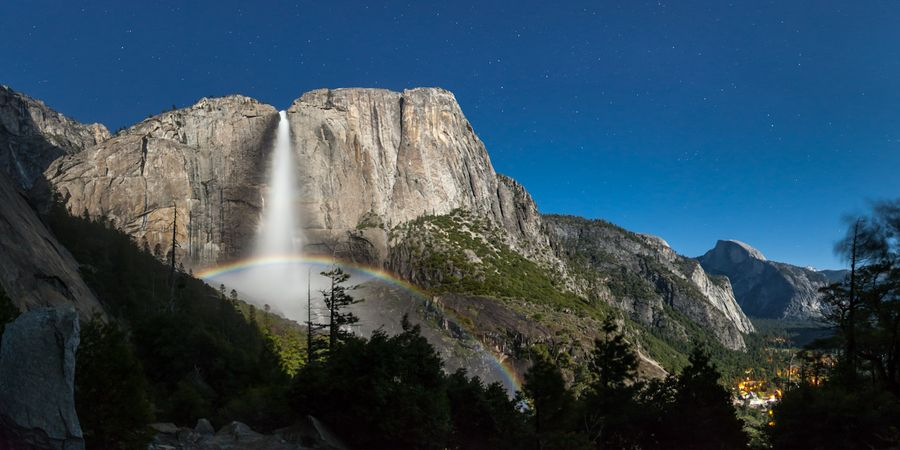 Moonbow (lunar rainbow) at Yosemite falls photographed at about 2AM during the May 2012 super moon.  Half Dome is on the right. (photo by Brian Hawkins)