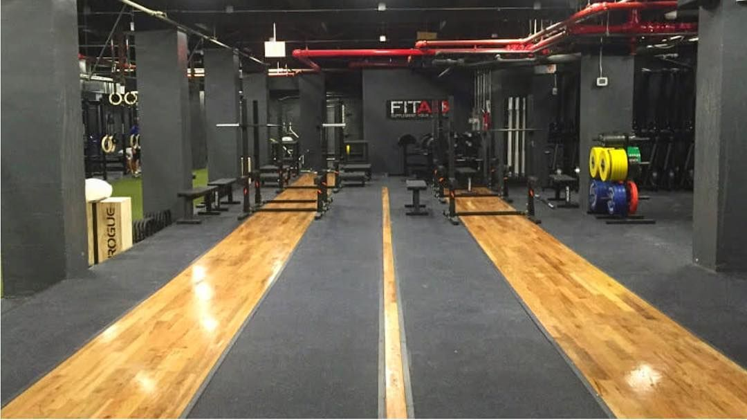 Nice Use Of Hardwood At Crossfitsolace Crossfit Crossfitgames Rurogue Asrx Weightlifting Fitness Garagegym Crossf Gym Design Dream Gym Container House