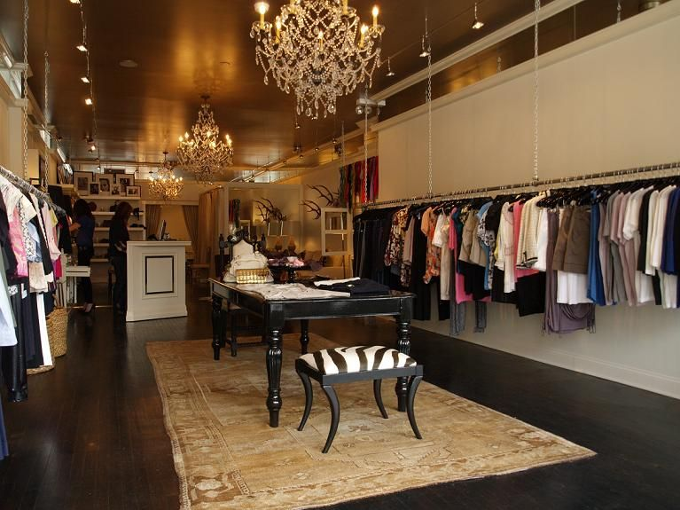 Boutique gold ceiling carpet and table setup the space for Retail store setup ideas