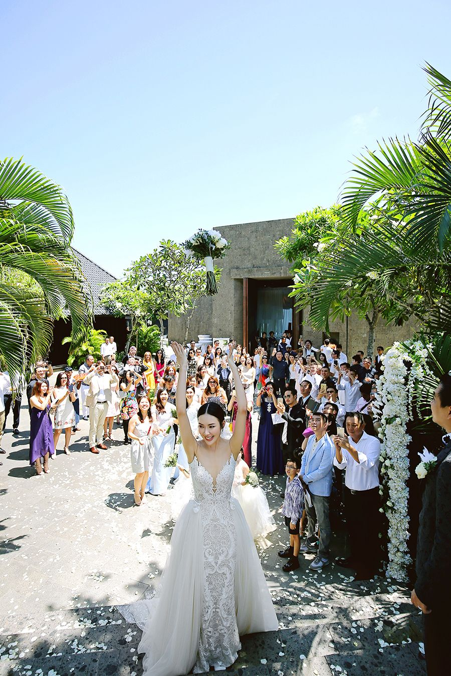 An Exciting Bouquet Toss As The Bride Celebrates Her Marriage In Stle With A Berta Wedding