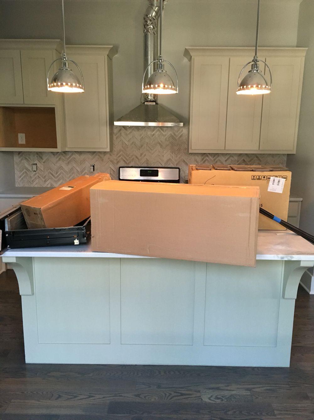Warm Kitchen With Limestone Chevron Backsplash, Chrome Fixtures And Carrara  Countertops. Superior Development,