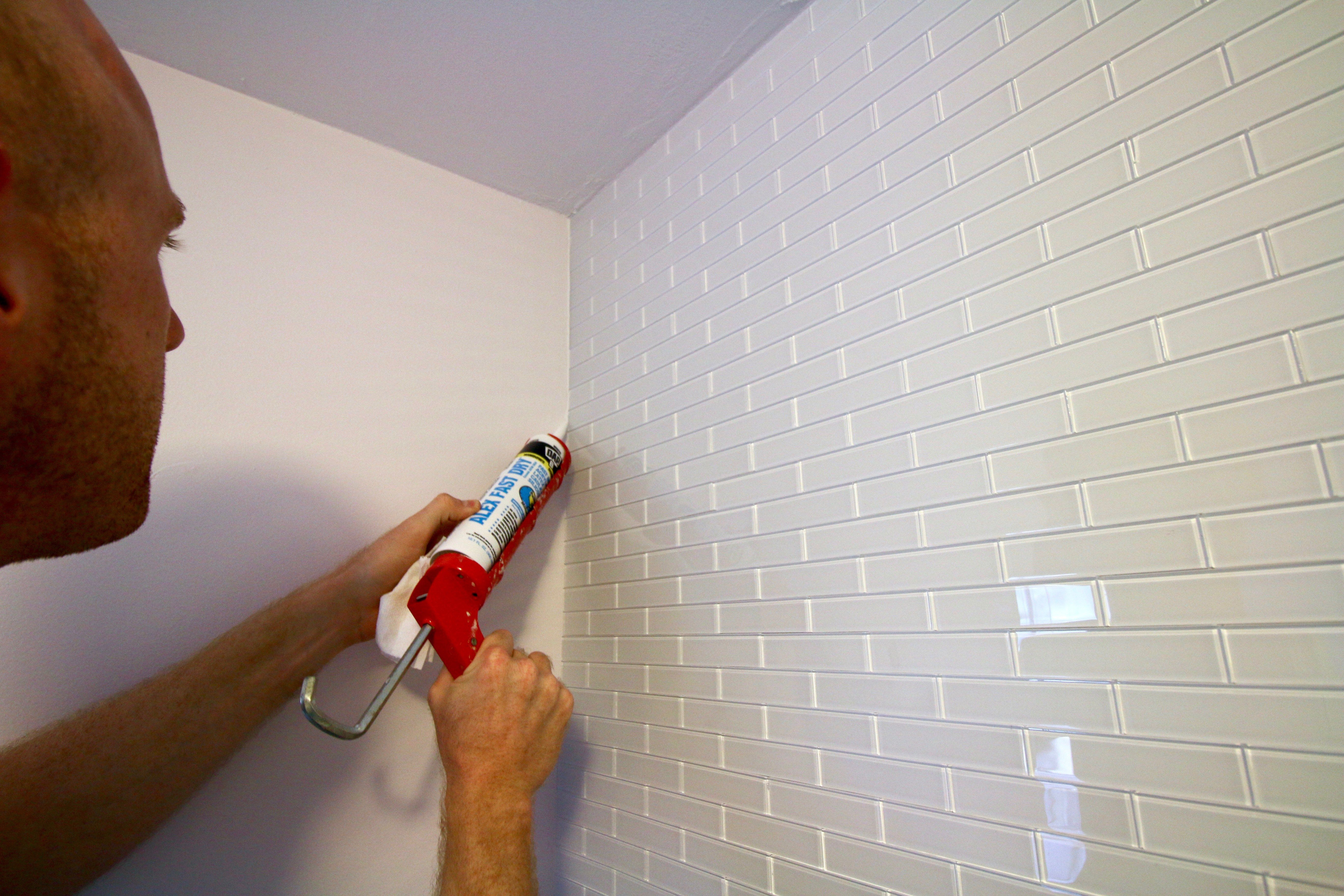 How To Hang A Peel Stick Aspect Tile Accent Wall Glass Subway Tile Tile Accent Wall Subway Tile