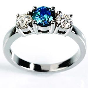 Such a pretty ring I really like the color of the gem My Style