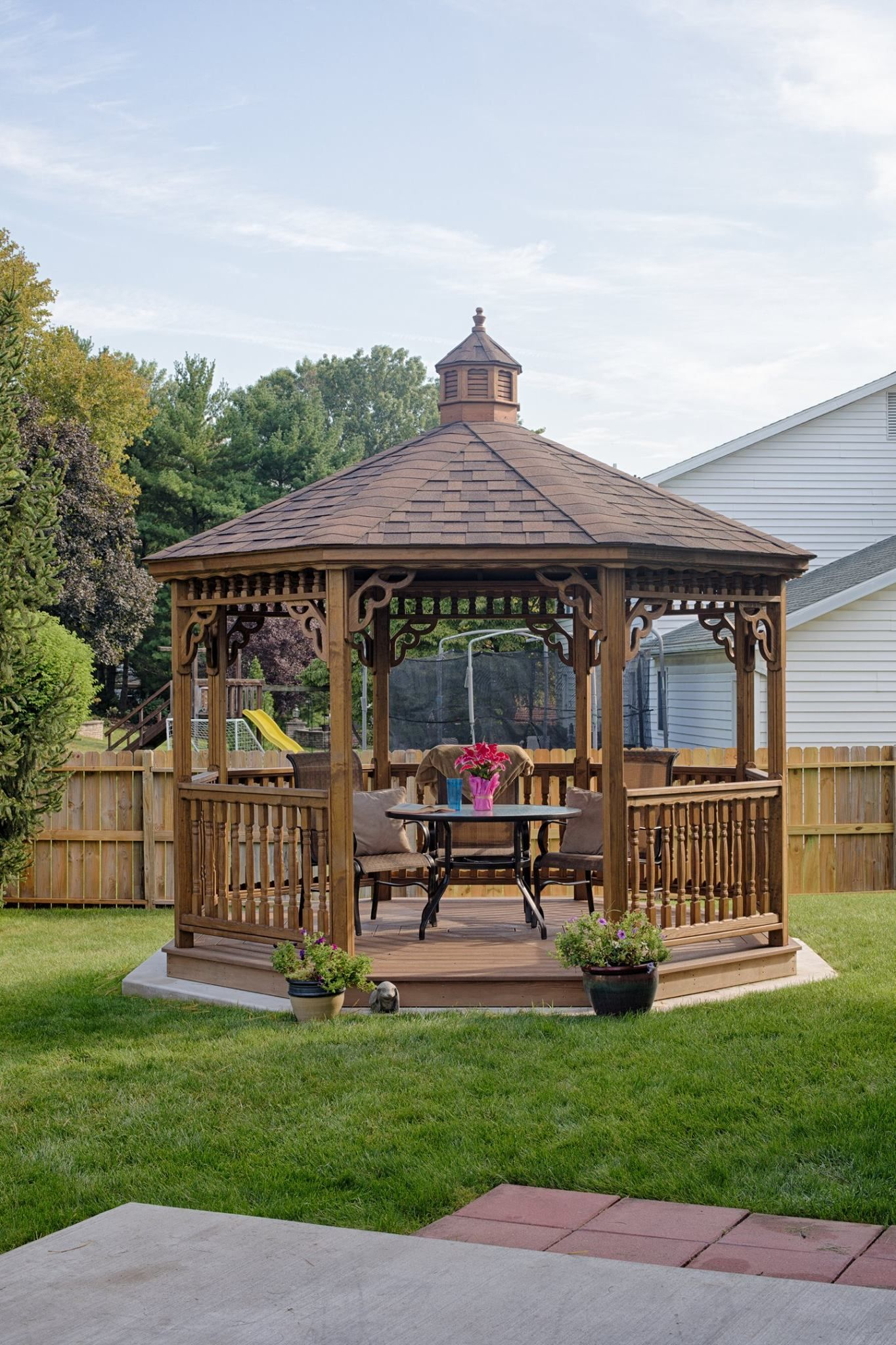 A New England Style Gazebo Is Perfect For The Outdoor Dining Experience.