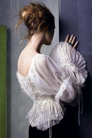 Donna Karan  - so feminine....