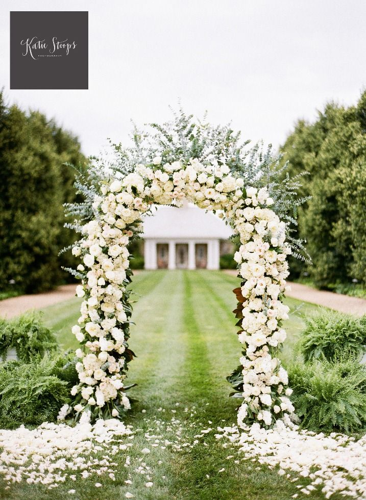 backyardwedding ceremony white floral arch Katie Stoops Photography ...