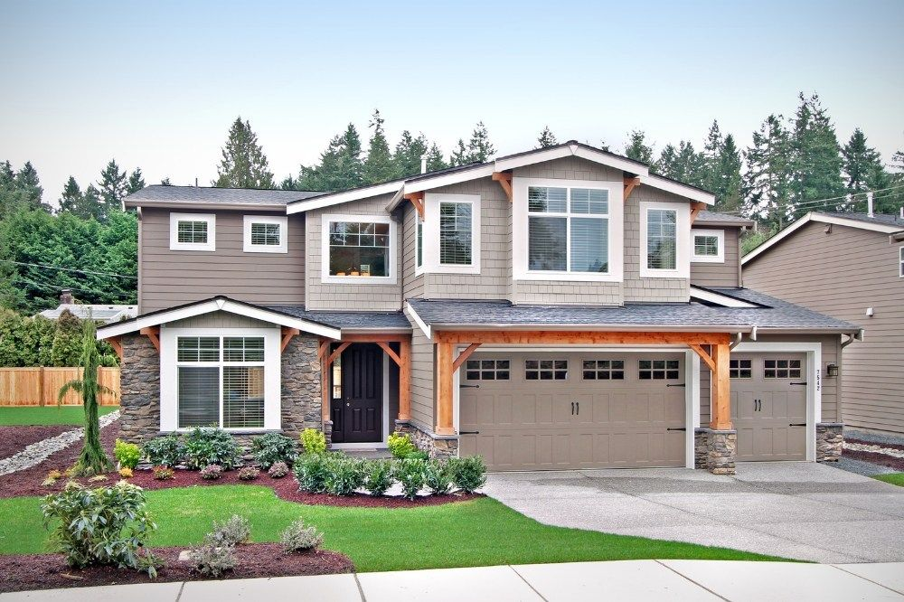 Timber And Stone Accent This New Home Built By Sundquist Homes In