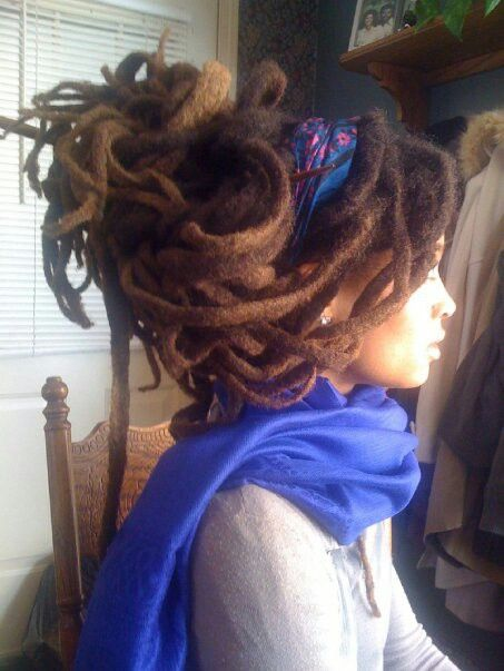 Not my type of style BUT I must admit that her locs are beautiful