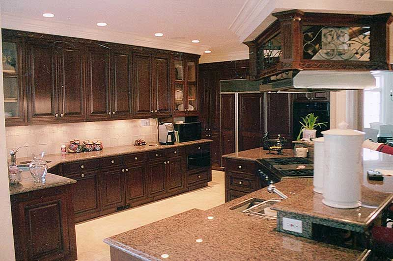 nice - mahogany wood, lighter counters, open an spacious with stove ...