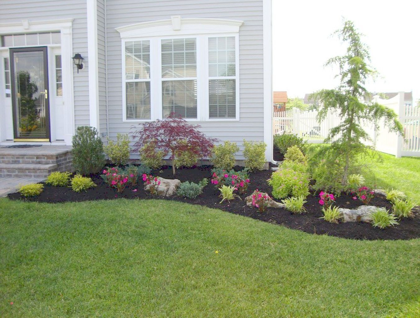 Products To Help Keep Your Grass Green Front House Landscaping
