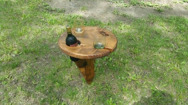 He stuck the table into the ground grabbed a bottle of wine and diy do it yourself wine table portable picnics summer outside camping solutioingenieria Gallery