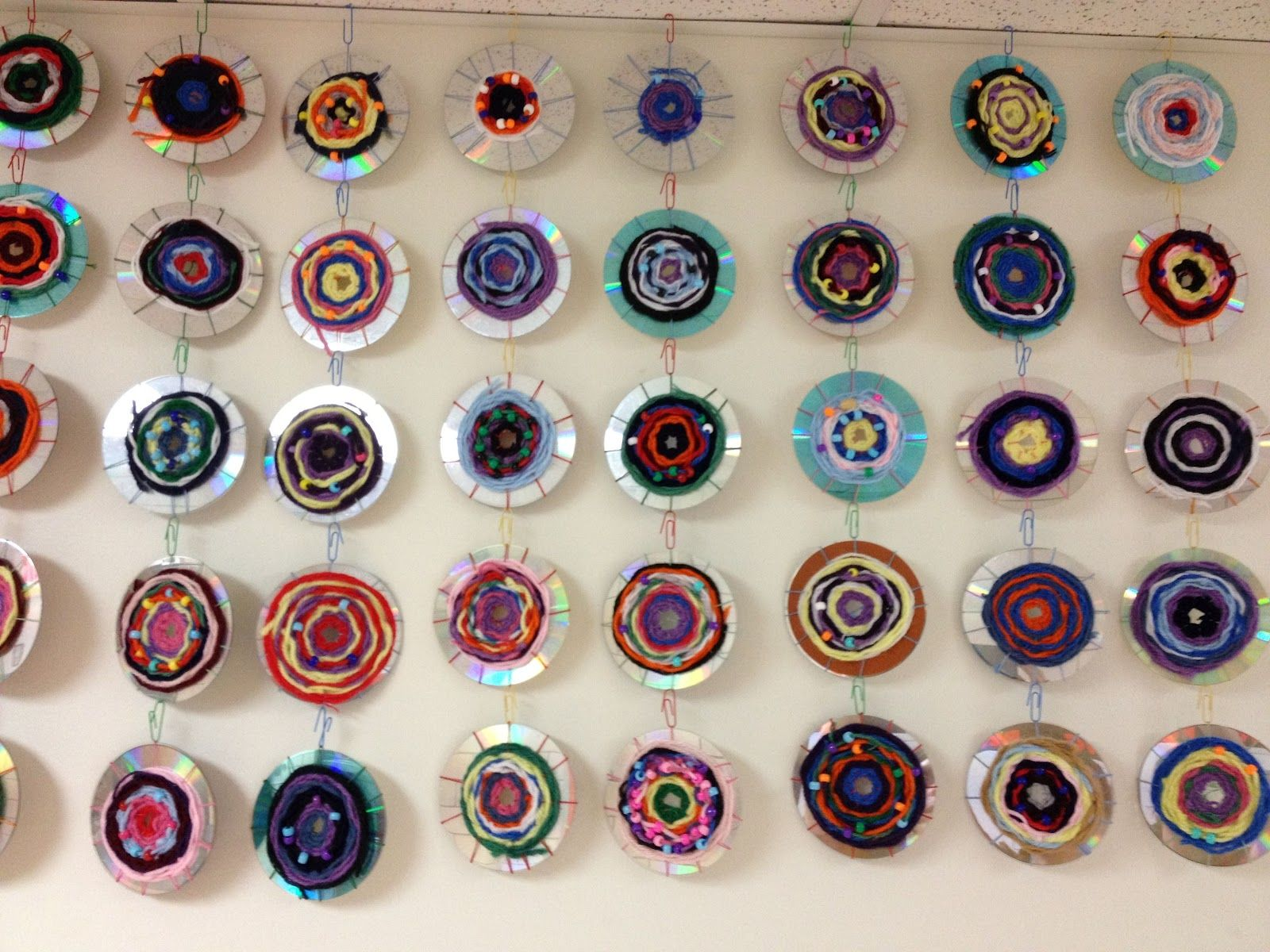Recycled CD weavings- Splats, Scraps and Glue Blobs #recycledcd