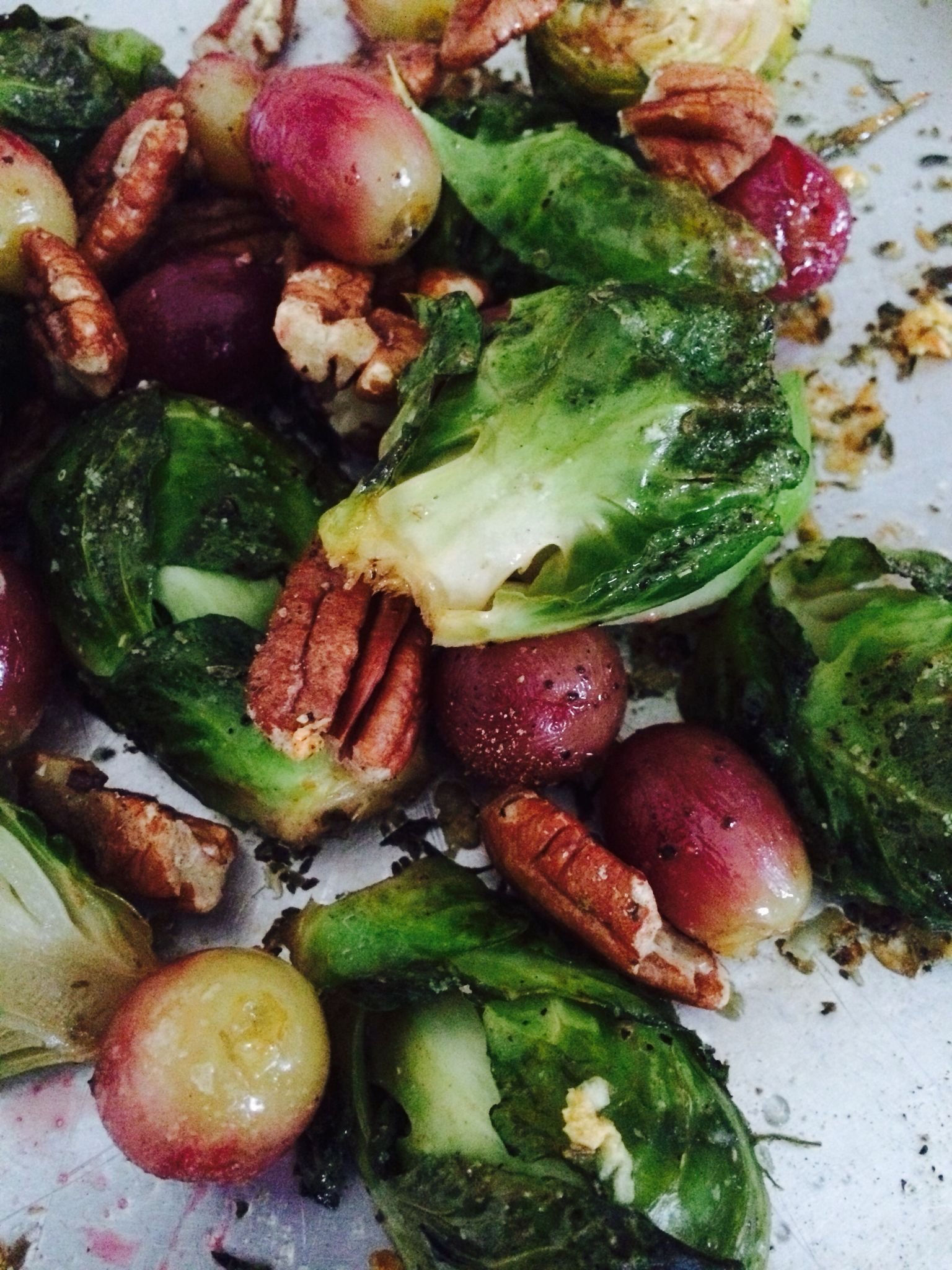 Baked Brussels Sprouts in garlic and olive oil with pecan nuts and red seedless grapes.