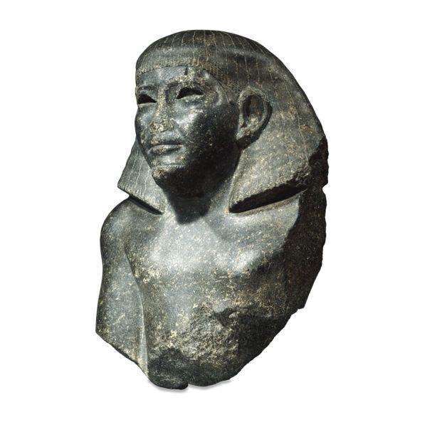 Black granite statue of Sarenput, The governor of Elephantine in the reign of Senwosret II. Perhaps from Elephantine, Egypt 12th Dynasty, about 1900 BC
