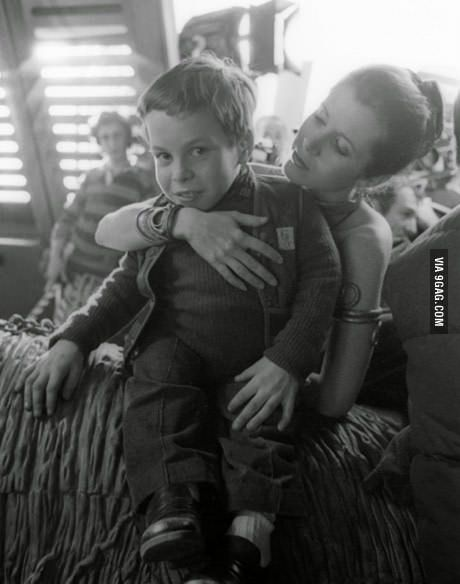 Carrie Fisher with 12-year old Warwick Davis on the set of Return of the Jedi, 1982