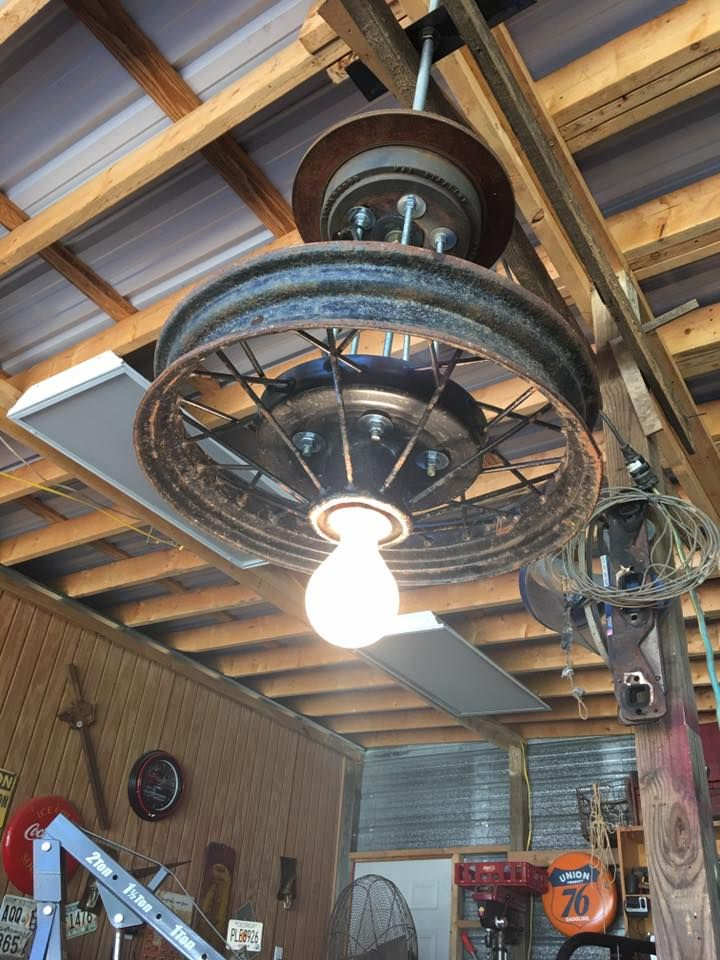 Vintage wheel converted to an overhead light fixture - Commercial lighting fixtures interior ...