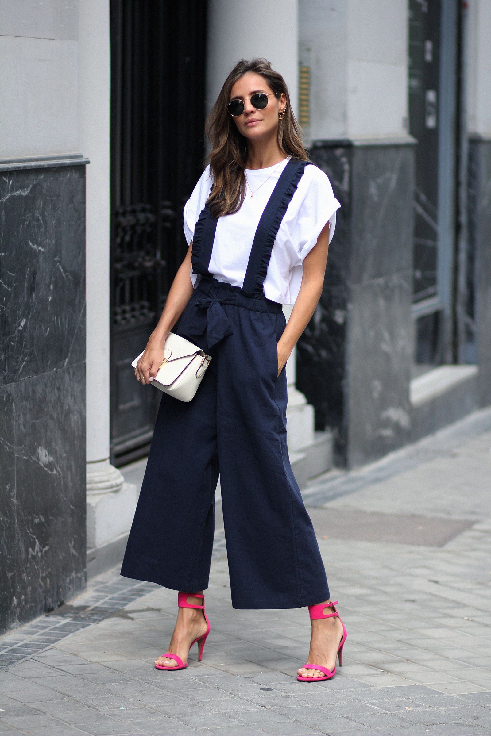 61b6c24a8a4 White top+navy wide-leg jumpsuit+pink  fuchsia ankle strap heeled  sandals+white clutch+sunglasses+earrings. Summer Dressy Casual Outfit 2018