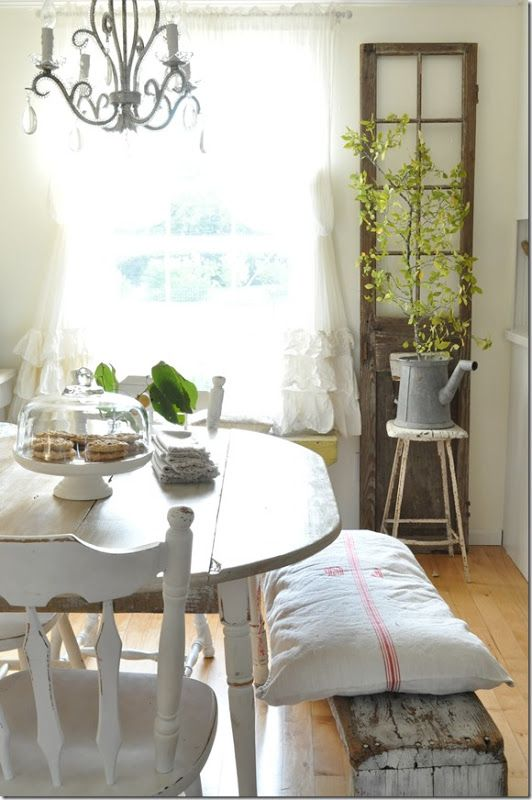 farmhouse dining with repurposed French door & galvanized watering ...