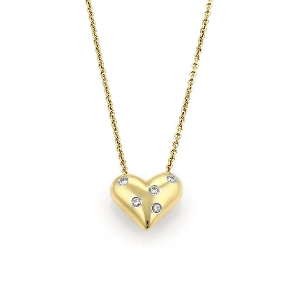 06bef3da9 Tiffany Etoile puff heart necklace by Tiffany & Co. is well crafted in  solid 18k yellow gold with 5 round cut diamonds set in platinum mountings.