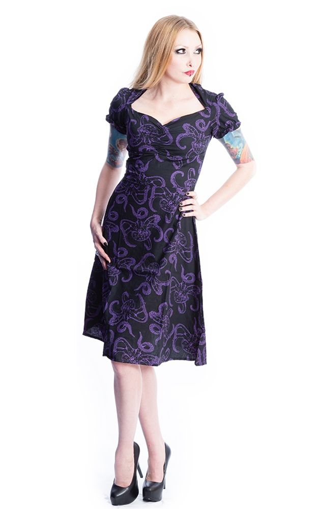 Vintage style dress from Necessary Evil featuring a gathered diamond neckline, puffed capped sleeves, and a fitted waist that flows down into an a-line flare skirt in a 1940's style. Made from 100% cotton in a Purple Octopus Print.