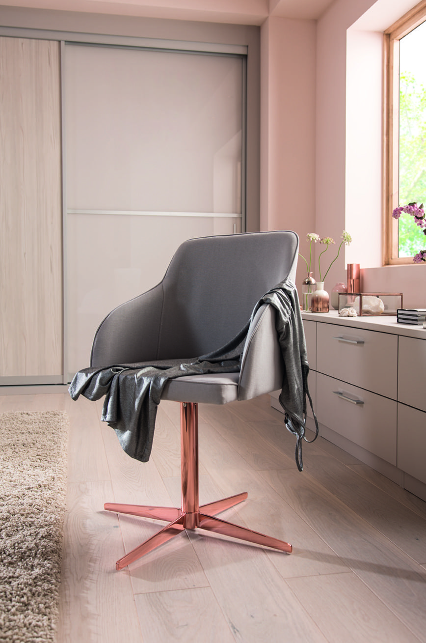 grey fabric chair with copper legs perfect for a