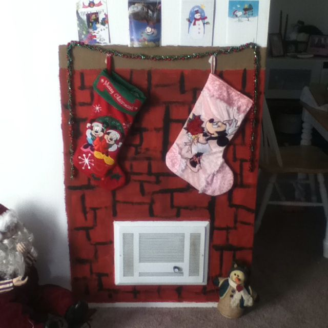 Construction paper fireplace for apartment. | Holiday decor, Decor, Christmas stockings