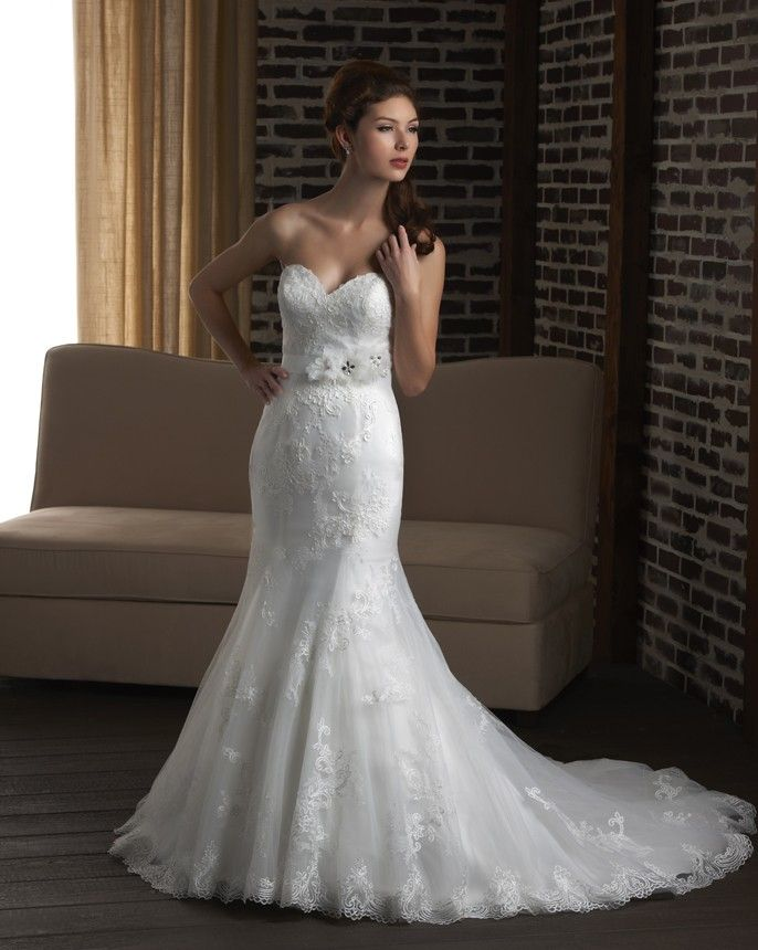 329 Strapless lace trumpet gown with beautiful hemline with a sash. #Straplessweddingdresses #Laceweddingdresses #trumpetweddingdresses #weddingdresses